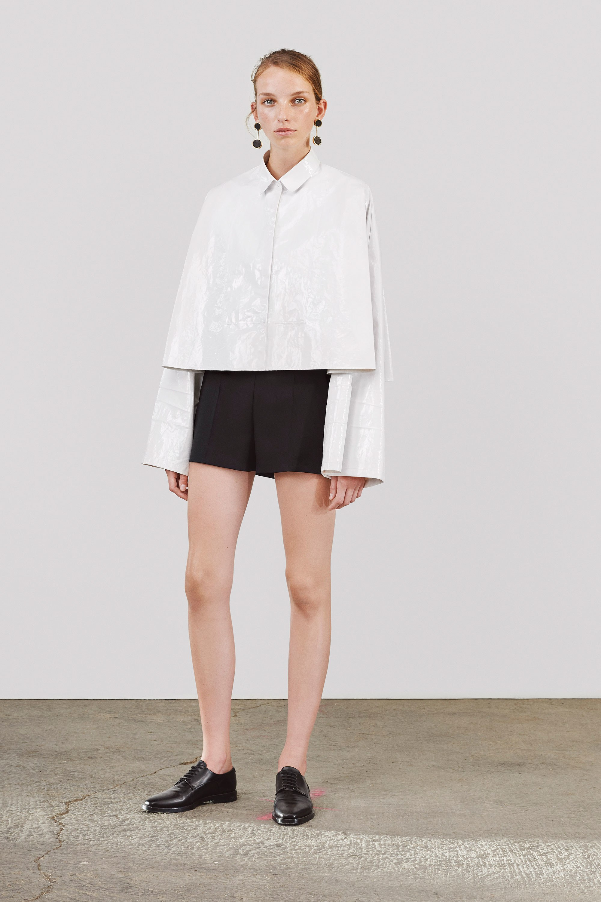 Jil Sander Collection white shirt black shorts summer outfit